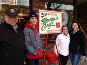 Rotarians and Interact students work side-by-side to ring the Salvation Army bell.