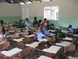 The children check out their new desks at La Escuela Cajuil in Macao, Dominican Republic.