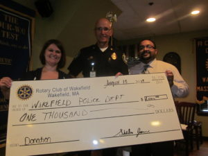 Wakefield Past President Amy Luckiewicz, Police Chief Rick Smith, and Club President Shibu James