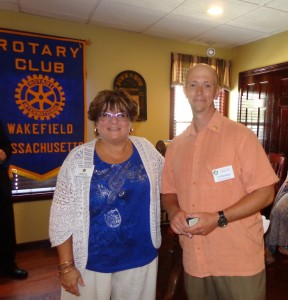 Rotary District 7930 Assistant Governor Joan Arsenault presented the award to Ed Harding in late July.