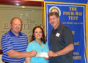 Wakefield Rotary Club Vice President Bob Kimball (left) and President Bob Mailhoit (right) presented a donation to Beebe Library Director Sharon Gilley earlier this month.