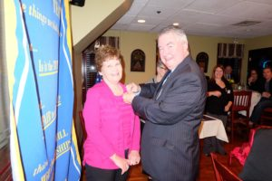 Rotarian Dick Reidy honors his wife Anne with a Paul Harris Fellowship award.