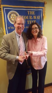 James Taylor receiving his pin from Foundation Chair Barbara Worley.