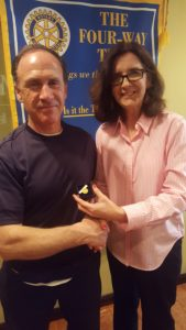 James Fitzgerald receiving his pin from Foundation Chair Barbara Worley.