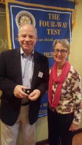 Tom Stapleton receiving his pin from Judy Gordon.