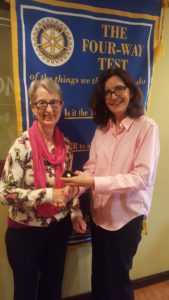 Judy Gordon receiving her pin from Foundation Chair Barbara Worley.