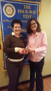 Suzanne Bowering receiving her pin from Foundation Chair Barbara Worley.