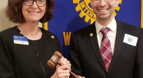 Mario Portillo passed the gavel to Barbara Worley during the installation ceremony.